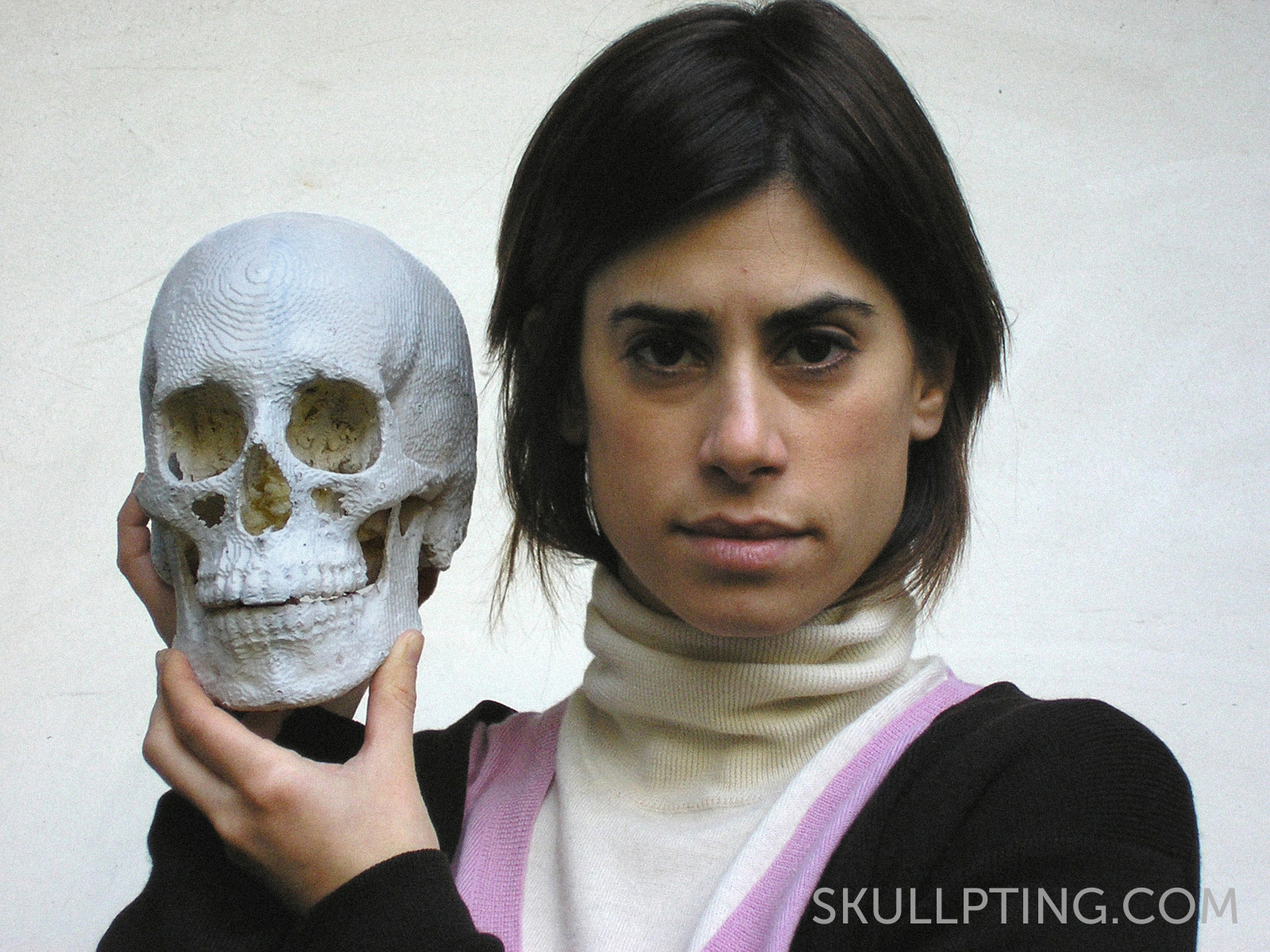 The artist with her 3D-printed skull.
